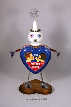 """""""Hugs and Kisses"""" ~ Original found object/junk art created by Laurie Schnurer in 2015. The tin also opens."""