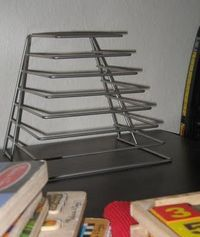 File holder turned puzzle rack -- genius!