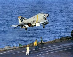 "A Navy Phantom from ""Jolly Rogers"" Fighter Squadron takes to the sky of the carrier deck. Us Navy Aircraft, Us Military Aircraft, Navy Aircraft Carrier, Military Jets, Airplane Fighter, Fighter Aircraft, Fighter Jets, F4 Phantom, Navy Marine"