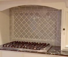 Backsplash: Highland Park Dove Gray 3x6 field with arabesque pattern, framed in crown molding and edged in matching quarter round