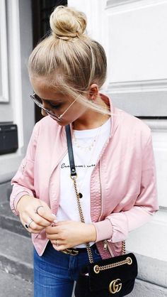 casual outfit inspiration / pink bomber + bag + white top + jeans