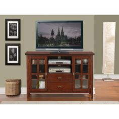 Complete your living room with the simple elegance of the Stratford TV and media console. A central open area and closed side cabinets allow for plenty of space for all types of media and gaming components.
