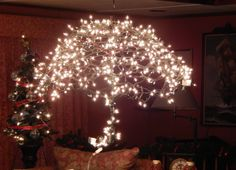 A Fabulous Wedding & Baby shower decoration. Take an old umbrella apart and wrap white lights around it. Takes 4 hours. A sure stunning look to hang or place on gift table