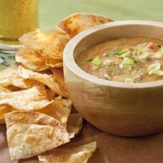 Chile Con Queso:  Our healthier version of chile con queso will have ooey-gooey-cheese lovers celebrating. Now you can enjoy this Tex-Mex dip without all the fat and calories. We replaced some of the cheese with a low-fat white sauce and used sharp Cheddar plus a splash of beer to boost the flavor. Our version cuts the calories in half and reduces total fat and saturated fat by nearly 60 percent.