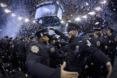 New York Police graduates hug following their induction ceremony at Madison Square Garden in New York, December 27, 2013. The NYPD graduated 1171 recruits to ranks of police officer. REUTERS/Carlo Allegri