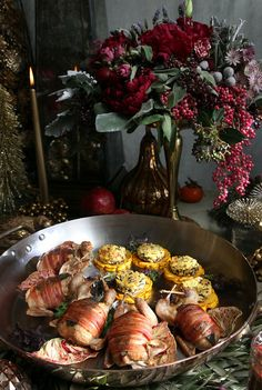 Description of . Pancetta-wrapped Quail and butternut squash with brioche and wild rice stuffing is displayed as part of a luxurious yet rus...