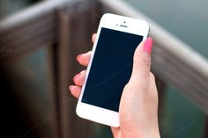 iPhone 5 mockup with a woman's hand by Jan Vašek on Creative Market