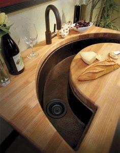 Crescent shaped sink