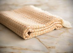 Peshtemal, also known as Turkish Towel, is a thinner alternative to terry towel. It was created with a the intent of taking a lighter towel to the