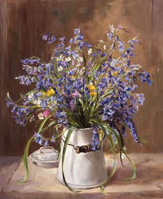 """Bluebells picked from the surrounding hedgerows where Anne Cotterill lived are arranged in a white enamel milk jug with other small wild flowers of spring; Bluebells, Stitchwort and Campions.  Size 15½"""" x 18½"""" approx. (39cm x 46.5cm). From an original oil painting.   Find out more.. http://www.millhousefineart.com/prints/bluebells-milk-jug-limited-edition-print"""