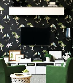 Paint the wall behind the TV a dark color so it doesn't stand out so much.  From apartment therapy