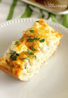 Cheesy Shrimp & Artichoke Bread Recipe - A perfect, easy appetizer made with a cheesy, creamy topping filled with shrimp and artichokes! ~ https://www.julieseatsandtreats.com