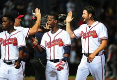 Jason Grilli Photos - Manager Fredi Gonzalez #33 of the Atlanta Braves celebrates with Pedro Ciriaco #13 and Jason Grilli #39 after the game against the Washington Nationals at Turner Field on July 2, 2015 in Atlanta, Georgia. - Washington Nationals v Atlanta Braves Atlanta Georgia, Atlanta Braves, Turner Field, Washington Nationals, Game, Celebrities, Photos, Celebs, Pictures