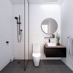 I call this LUST. Call it basic, call it simple but don't underestimate the power of Black in the bathroom. If I were another bathroom I'd want to date YOU. @fieldwork_architects creating dream apartment bathrooms in our curated elements: monochrome & minimalist.                                                                                                                                                                                 More