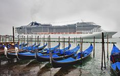 MSC Divina passes in front a gondola station in St Mark's Square on Saturday amid claims it is far to big to enter Venice.