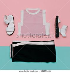 Flat lay fashion set: white sandals shoes black striped trousers and top on minimal background. Line style. Top view.