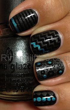stripes and dots in silver and turquoise glitter over black manicure