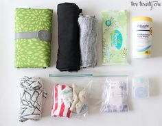 Baby Car Kit - diaper changing pad with a couple of diapers and wipes, change of clothes for mom, change of clothes for baby, nursing pads, hand wipes and pacifier. In winter could add blankets, snacks and water in case you get stranded.
