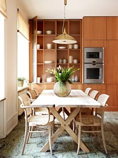 "Ben Gorham's kitchen ""features Oregon pine cabinets with stainless steel counters and a floor of green Swedish marble called Brannlyckan, popular in the 1920s."""