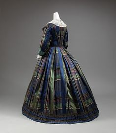Dress    Date: 1858–60    Culture: American    Medium: silk    Dimensions: [no dimensions available]    Credit Line: Gift of Lee Simonson, 1938    Accession Number: C.I.38.23.56    Metropolitan Museum of Art, New York
