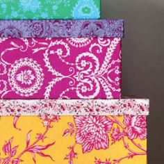 """Use that extra upholstery fabric to jazz up storage boxes! From """"house beautiful"""""""
