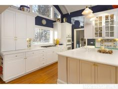 A chef's dream kitchen with extra large counter work area and gorgeous patterned backsplash.