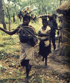 Civilian ammunition bearers pass through a village close to the frontline.Having gained i...