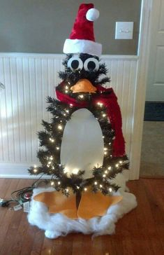 christmas tree themes 12 Truly Mind-Blowing Christmas Tree Decorations - Womans World Penguin Christmas Decorations, Mickey Mouse Christmas Tree, Christmas Tree Themes, Xmas Tree, White Christmas, Christmas Holidays, Funny Christmas Tree, Christmas Kitchen, Christmas 2019