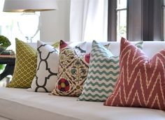 20sq. Schumacher KASARI Ikat pillow cover in Poppy (far right) like the blue/green and raspberry color combo with a splash of navy.