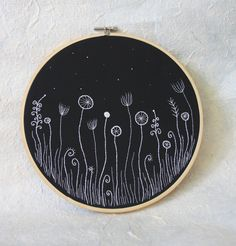 "Hand Embroidery Hoop Wall Art ""Flowers in the Night"" -  hand embroidered 9,4"" wall hanging. $63.00, via Etsy."