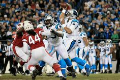 Cam Newton #1 of the Carolina Panthers looks to throw a pass in the first quarter against the Arizona Cardinals during the NFC Championship Game at Bank of America Stadium on January 24, 2016 in Charlotte, North Carolina. (Jan. 23, 2016 - Source: Mike Ehrmann/Getty Images North America)