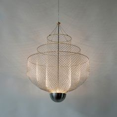 The Meshmatics Chandelier is created by Rick Tegelaar out of chicken wire.