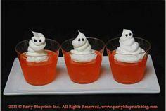 orange Jello , reddi whip ghost , mini chocolate chips for eyes.