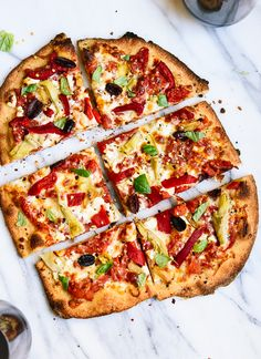 Greek pizza recipe, featuring feta, roasted red peppers, artichoke and olives!