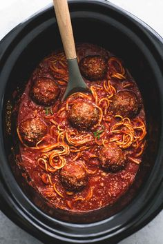 Easy set it and forget it one pot slow cooker spaghetti and meatballs will be your go-to healthy spaghetti recipe! Everything is cooked in the crockpot - even the noodles! | lecremedelacrumb.com