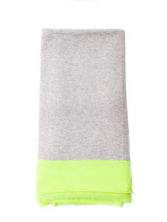 Neon Cashmere Travel Wrap. A supercosy, stylish travel wrap in classic grey with modern neon flashes of colour. Ideal for trips away, winter walks or even cosying up in front of the fire. and an ideal luxury gift for someone special or a very justifiable gift to self. £185 #gifts #gift #her #travel #cashmere #ideas