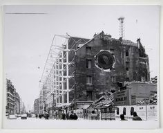 "Gordon Matta-Clark - Conical Intersect (1975) ""Conical Intersect manifested Matta-Clark's critique of urban gentrification in the form of a radical incision through two adjacent 17th-century buildings designated for demolition near the much-contested Centre Georges Pompidou, which was then under construction."