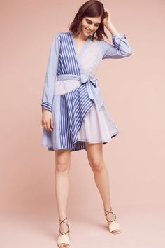 Newport Stripe Shirtdress from Anthropologie is perfect to throw on after a day in the sun. Add this stripped wrap dress to your must have list.