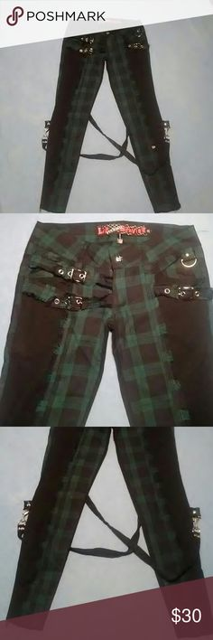 """NWT LIP SERVICE PLAID SKINNY JEANS-SIZE 25 -Brand New with Tags -Lip Fu..... Service Black & Green Plaid Skinny Jeans -Size 25 -2 zipper pockets in back, and 2 pockets in front -Lots of buckles & latches -5"""" zippers at the bottom of each pant leg -65% Polyester, 35% Rayon -97% Cotton, 3% Spandex -Waistline measures 14 1/2"""", laying flat -Inseam measures 26"""" in length Lip Service Pants Skinny"""
