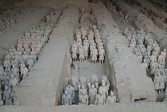 Qin dynasty (221-206 BC)     The emperor Qin was buried with several thousand life-sized terra-cotta warriors.  Their function was literally to guard the body in the afterlife.  Lintong, Shaanxi Province, China
