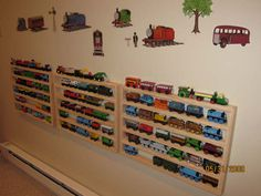 3 Train Rack Basics can be bought at the Train Rack store. Many different Train display shelves. Thomas Train Storage Ideas - Use this Rack for a wall display and organization. Train Bedroom, Wall Storage, Wall Racks, Bedroom Storage, Storage Shelves, Wall Of Fame, Thomas The Train, Toy Rooms, Thomas And Friends