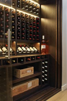 Wine Wall with Sliding Doors Detail London Cellar Maison are specialists in creating bespoke, climate controlled wine cellars and wine rooms tailored to suit your property, interior design, style and wine collection. Under Stairs Wine Cellar, Wine Cellar Basement, Spiral Wine Cellar, Armoire Bar, Home Wine Cellars, Wine Cellar Design, Wine Display, Wine Wall, Wine Cabinets