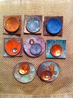 New pendants mixing poly clay pieces coated with metallic surfaces & heat oxidized copper bits.