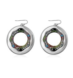 Step out in style wearing these beautiful statement earrings. They're modern and colorful. These unique open circle silver earrings dress up simple denim and add extra sparkle and pizzazz to a business jacket or dress. With an array of colorful crystals in shades of blue, lime green, orange and opal, these pretty earrings add a vibrant touch to your wardrobe. They're perfect for the modern woman with stylish good taste!