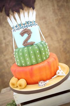LOVE this feather + boho + cactus cake! Bohemian Camping Themed Birthday Party…