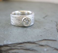 Wide band and bezel set.  All on Mamaw's yellow gold wedding band.