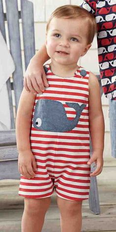 Red, white and blue comes to the forefront with this boys striped whale romper from Mud Pie for baby boys.  Decorating this boys cotton pique romper are red and white stripes, chambray whale applique and chambray shoulder buttons.  Inner leg snaps.  Perfect as a baby boys 4th of July outfit or for cruise vacations, bbqs and summer play dates.