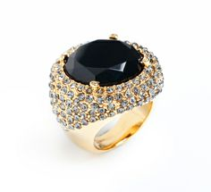 SASHA RING: SheBySheree. Cocktail style comes to life in this little number, featuring a single large, jet-black faceted stone with grey pave stones sprinkled around for added glam. At once understated and over-the-top, it's the perfect solution to an outfit needing a dose of added oomph. $40