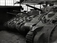 "January 1943. ""New M-4 tanks, which will soon be hurling their might against the Axis, in the Schenectady, New York, plant of the American Locomotive Company."" Photo by Howard Hollem for the Office of War Information."