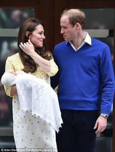 The Duke and Duchess of Cambridge could not have looked happier as they posed for pictures...